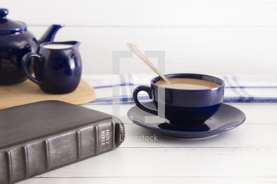 Tea Set with a Hot Drink and Bible
