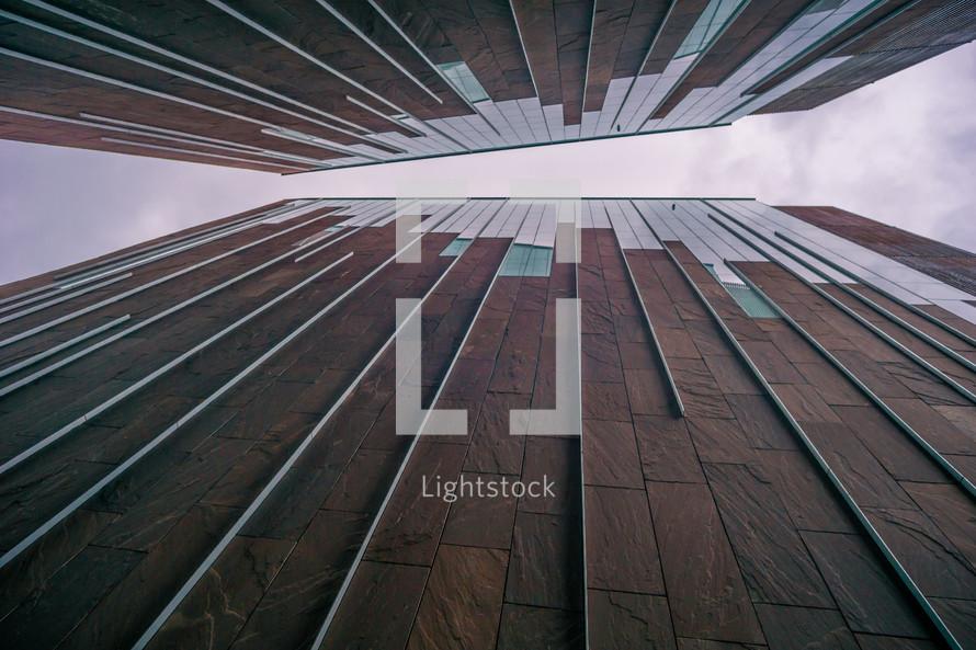 looking up through the narrow space between buildings