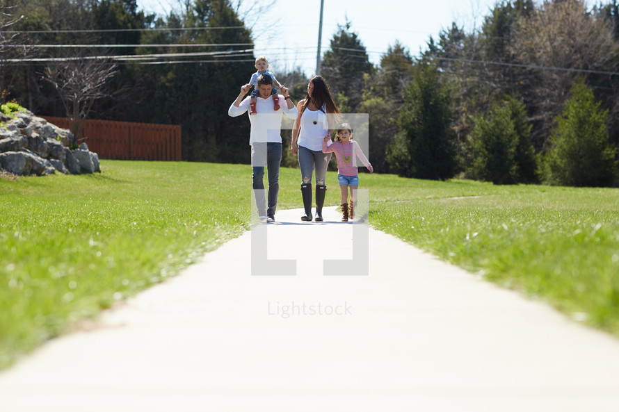 a family going on a walk in spring