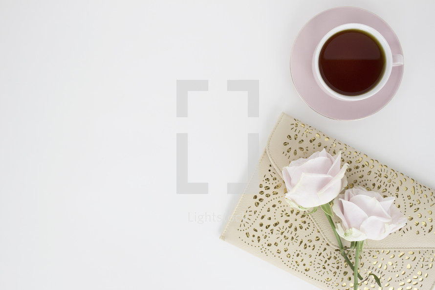 roses on a journal, and coffee mug