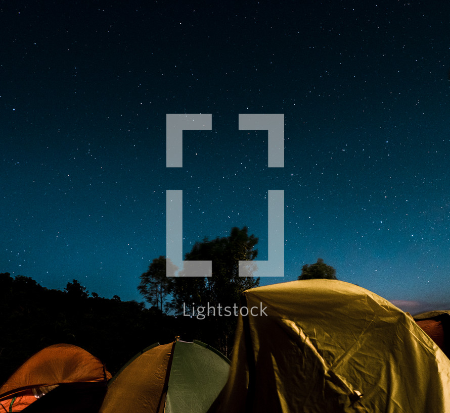 stars in the night sky over tents