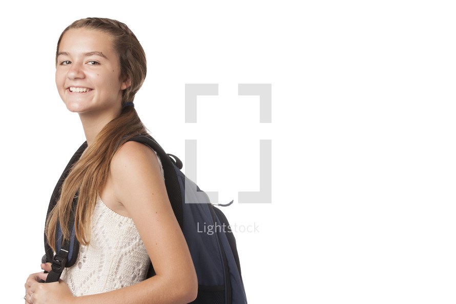 young student with backpack on white background.