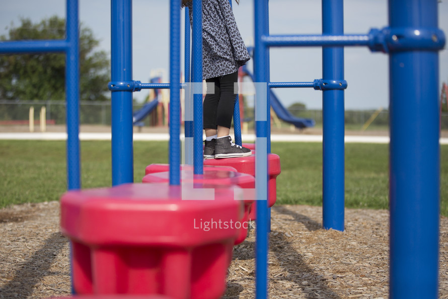 a little girl on a playground