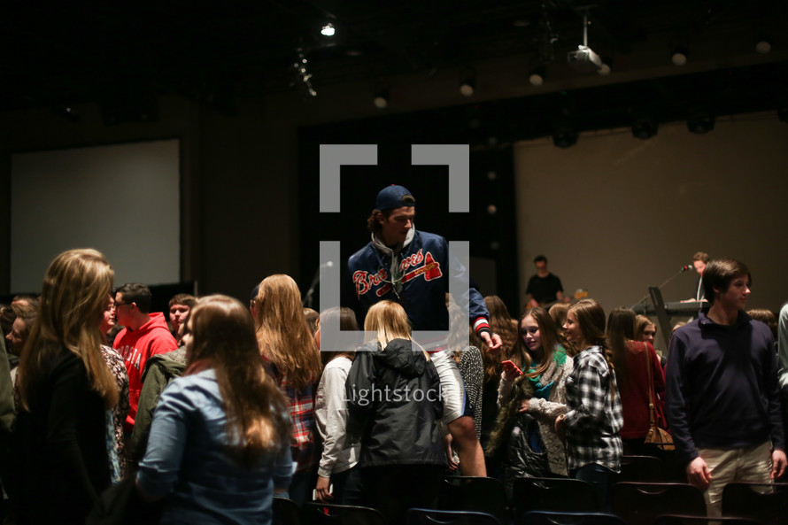 youth attending a worship service