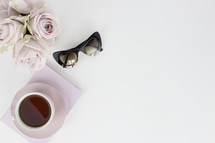 roses, sunglasses, coffee mug, and journal