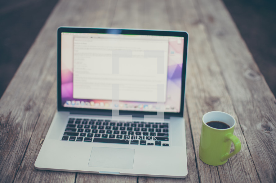 computer screen and coffee mug