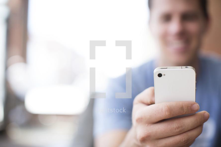 man checking his smart phone.