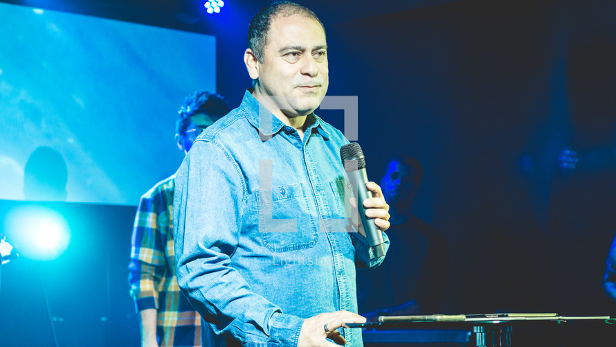 a pastor holding a microphone