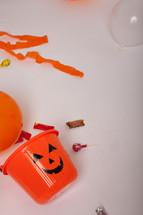 a jack-o-lantern bucket of Halloween candy