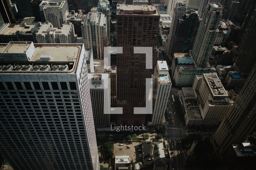 Aerial view of tall city buildings.