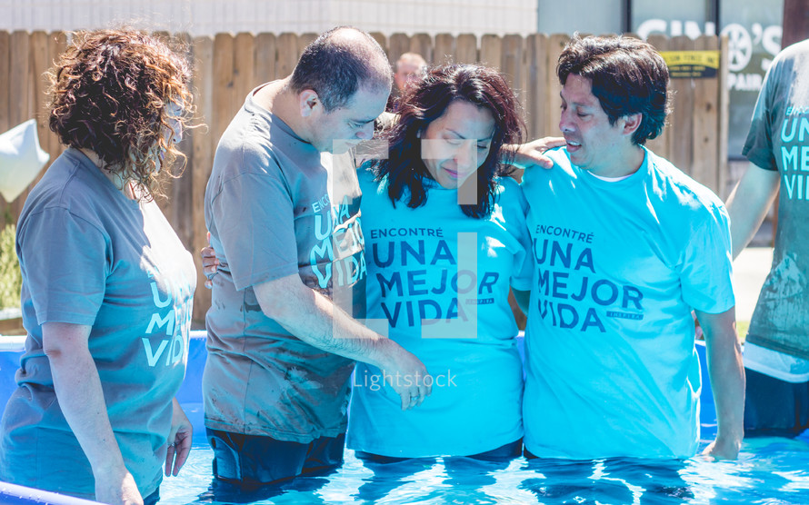 a couple being baptized