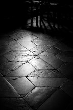 sunlight on a brick and tile floor in a cathedral