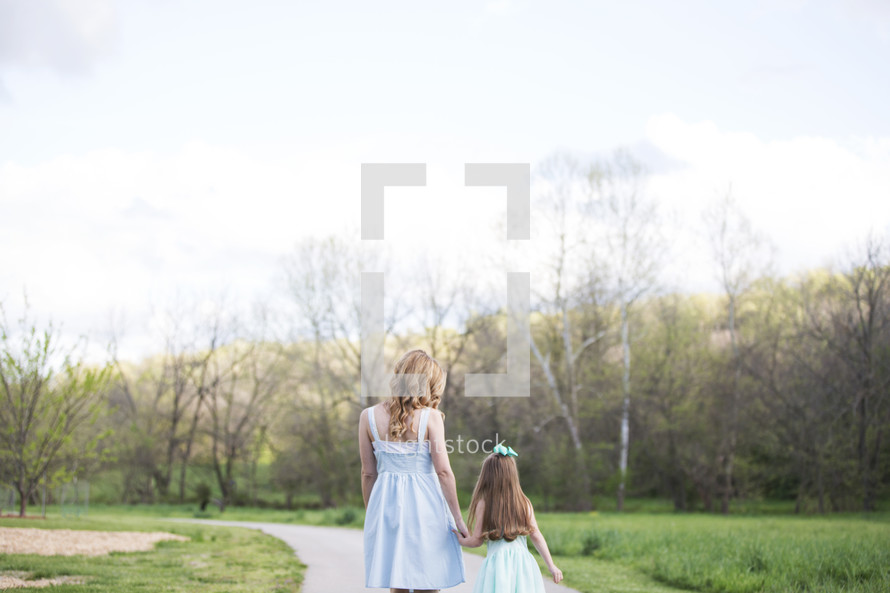 a mother walking with her daughter