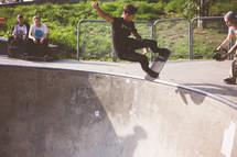 a man doing tricks on a skateboard in a skatepark