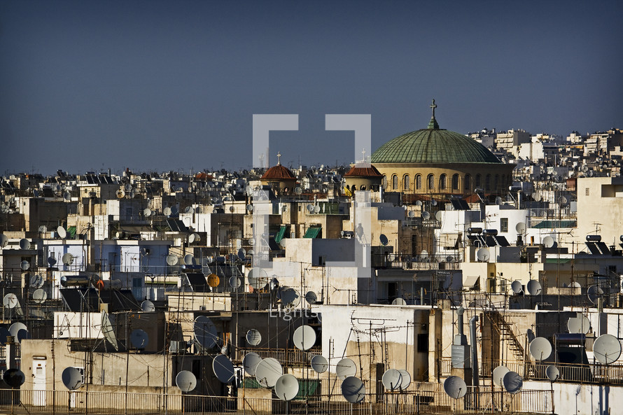 middle eastern church and satellite dishes