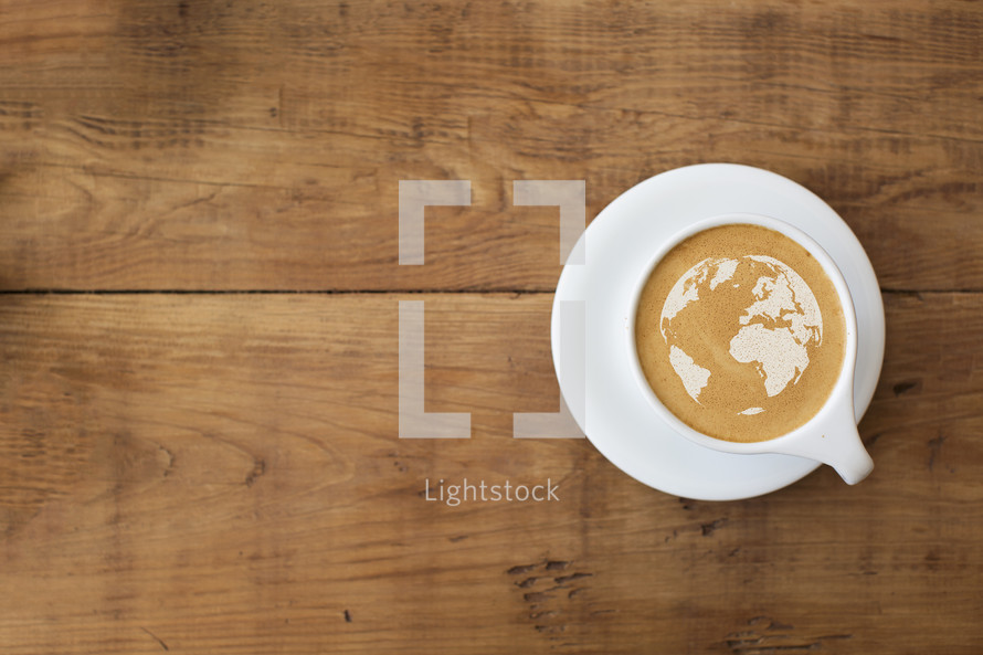 world map in the froth of a latte.