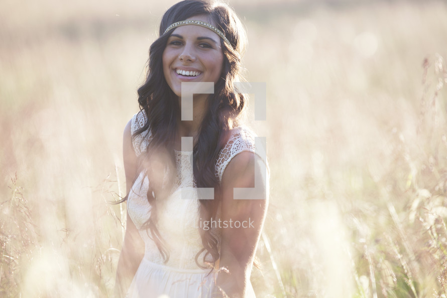Smiling woman in a wheat field.