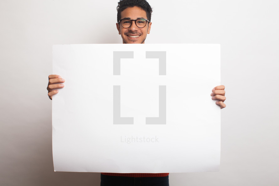 a man holding up a blank sign