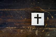 cross tile mosaic on a wood floor