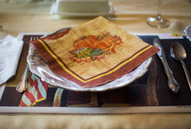 a Thanksgiving napkin on a plate