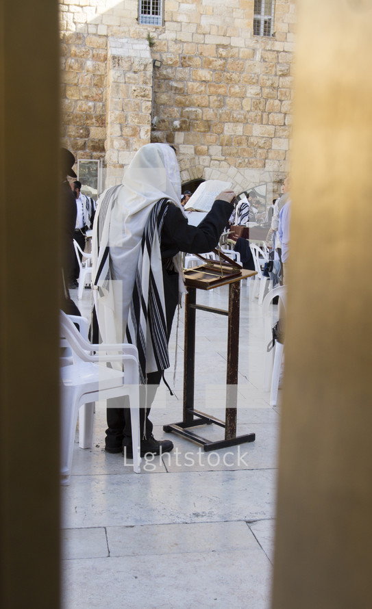 people praying at the wall in Jerusalem