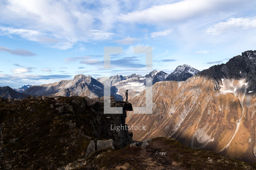 a person standing at the edge of a mountain