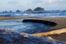 waves along a beach shore