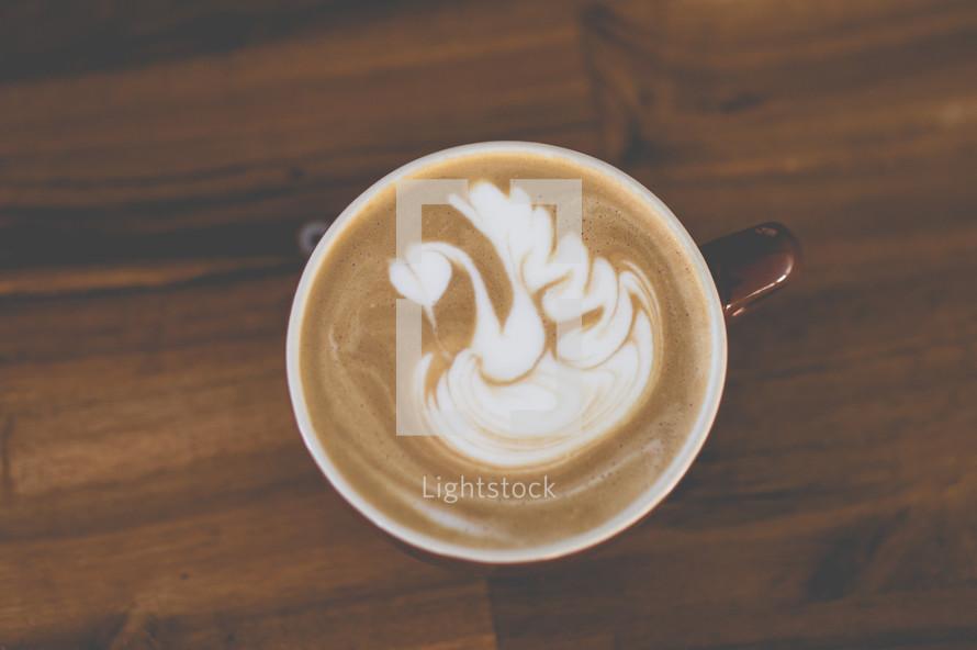 swan design in creamer in coffee