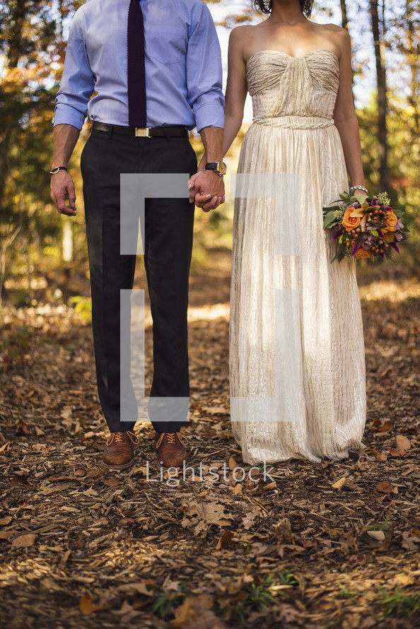 portrait of a bride and groom holding hands