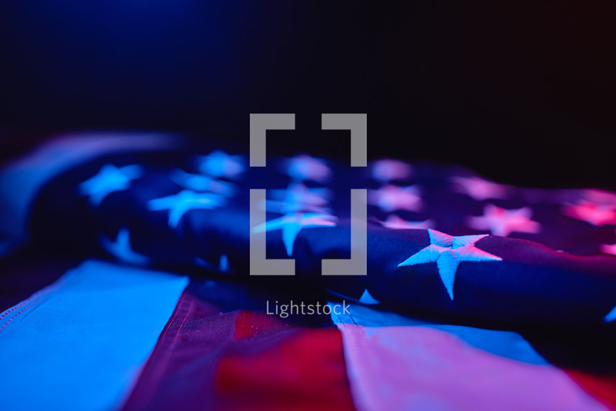 American flag under red and blue light