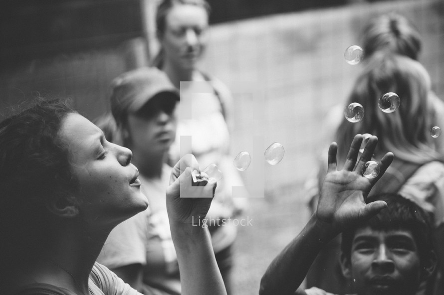blowing bubbles on a mission trip
