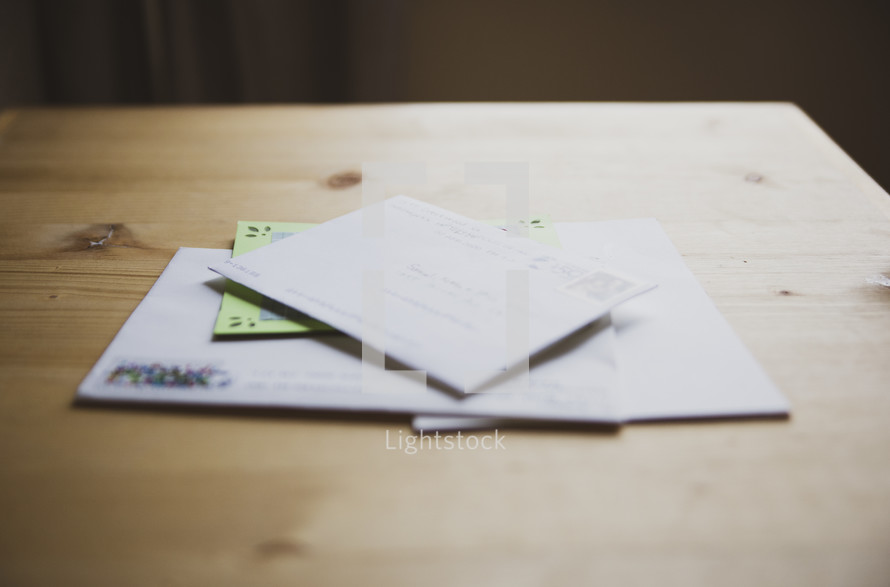 pile of envelopes on a table