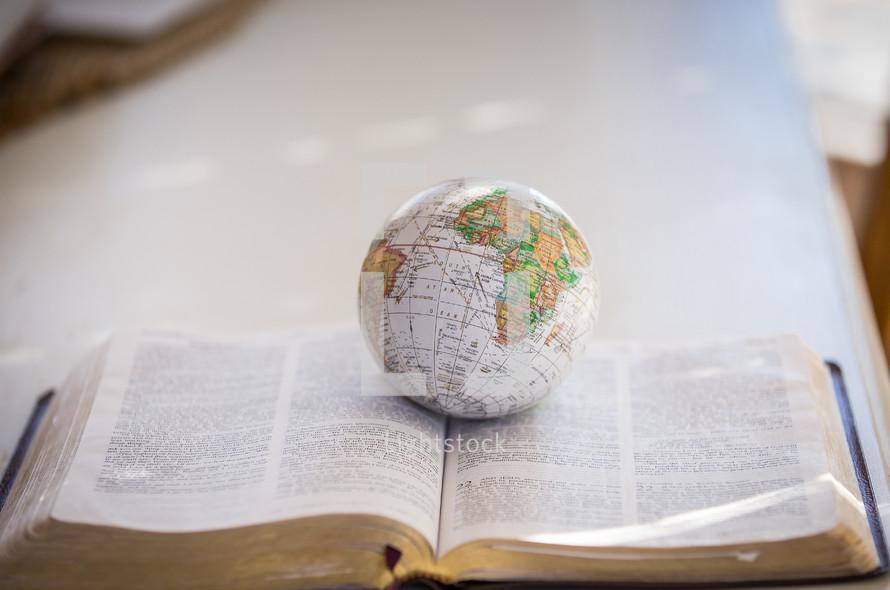 globe on a Bible
