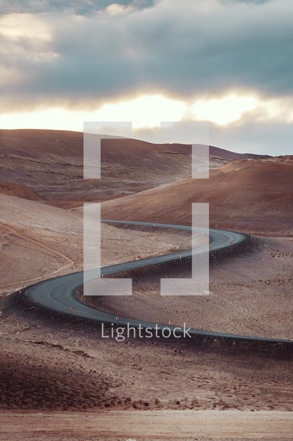 curvy road on desert mountains