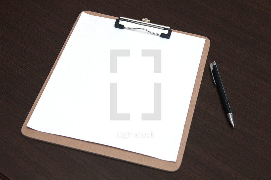 blank clipboard and a pen