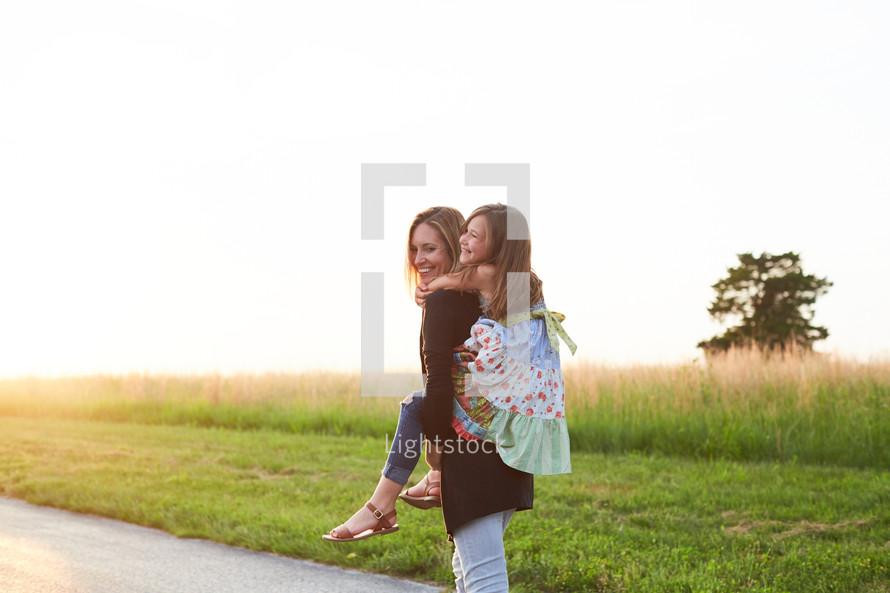 a daughter getting a piggy back ride