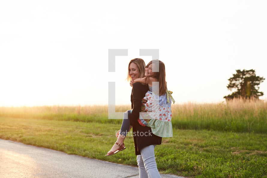 a daughter getting a piggy back ride