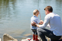a father fishing with his son.