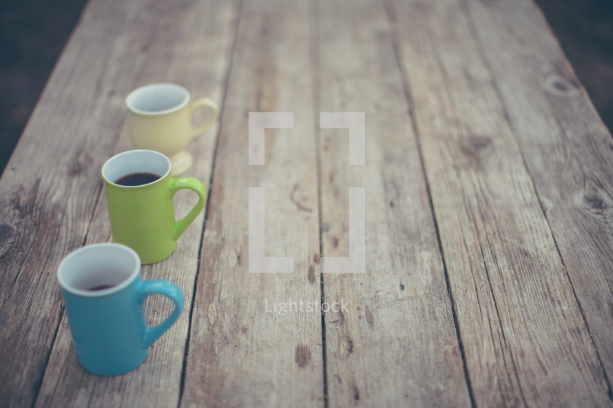 coffee mugs on a wood table