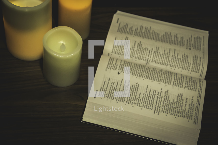 candles and an open Bible