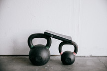 free weights at a gym and a Bible