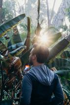 a man standing in a jungle