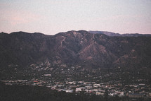 a town in a valley and surrounding mountains
