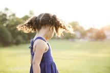 Girl standing outside.