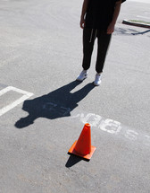 cone in a reserved parking space