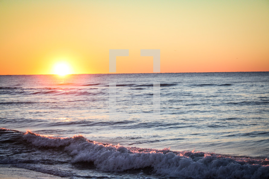 Sunset on the horizon of the ocean.