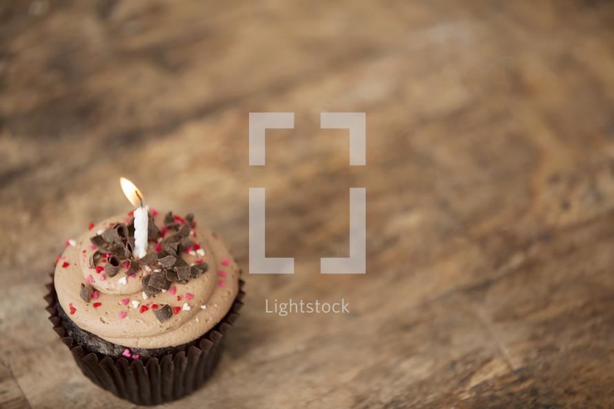 chocolate cupcake and candle