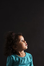 toddler girl looking up in amazement