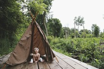 an infant in a teepee