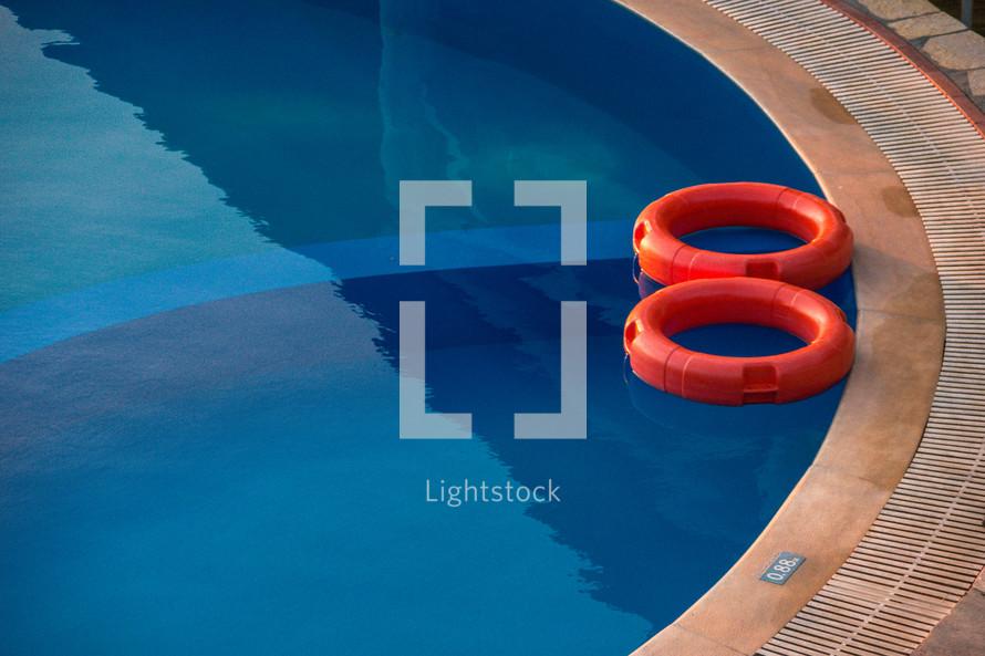 orange floats in a pool